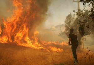 Athenians battle to contain fires burning out of control