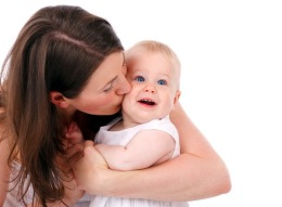 mother-kissing-baby-87129433012057t